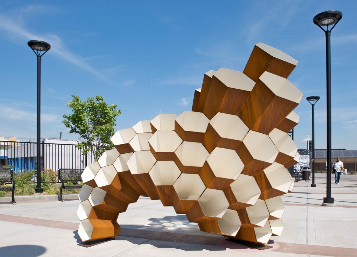 Hive is a public art sculpture by artist Janet Lofquist installed at the Delmar Transit Plaza. The sculpture is made of COR-TEN steel and has a honeycomb structure, symbolizing the collective spirit of the community.