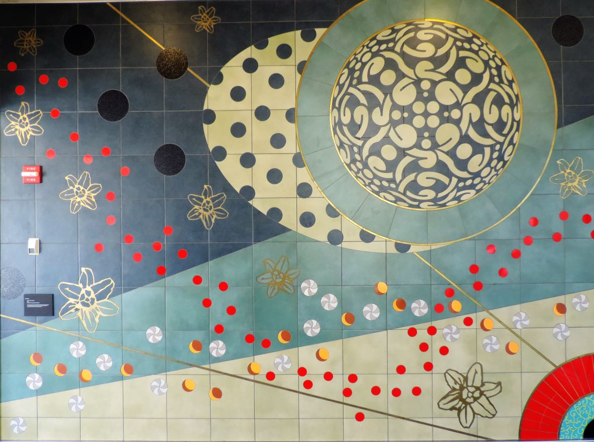Nucleic Life Formation is a public artwork created by artist Amy Cheng and installed at the St. Louis Lambert International Airport Terminal 1 MetroLink station. Made of ceramic tiles and brass, the piece includes two murals with abstract designs loosely resemblinging the structure of a DNA double helix.