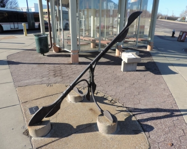 Sundial is a wrought-iron public art sculpture installed at the North Broadway Transit center. It was designed by artist Noah Kirby.