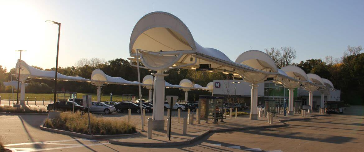 The North County Transit Center Bus Canopies were designed by artist/architect Andrew Leicester. Th canopies resemble the iconic forms of the Conestoga wagon, a symbol of transportation in the 19th century.