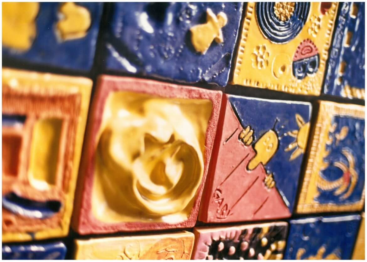 TileLink was the first permanent Arts in Transit installation and consists of glazed ceramic tiles made students and local residents. Artist Catharine Magel led the community design project.
