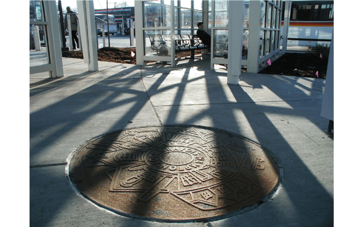 Medallion is a circular, cast-iron medallion embedded in the plaza of the Hampton-Gravois Transit Center and was created by artist Phil Robinson. Medallion reference local architectural motifs specific to South St. Louis.